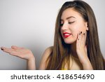 beautiful girl holding your... | Shutterstock . vector #418654690