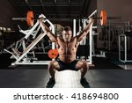 muscular man at a crossfit gym... | Shutterstock . vector #418694800