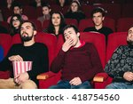 the guy on the boring movie at... | Shutterstock . vector #418754560