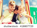 Small photo of summer, childhood, leisure, friendship and people concept - group of happy kids hugging on children playground