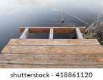 Small photo of A small landing stage on the calm clean river in the rural area in the European part of Russia.