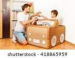 father and his son making toy... | Shutterstock . vector #418865959