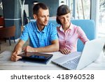 young man and woman with laptop | Shutterstock . vector #418960528