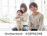 portrait of young asian family... | Shutterstock . vector #418996348