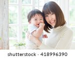 portrait of young asian family... | Shutterstock . vector #418996390