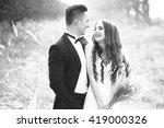 happy newlywed couple posing...   Shutterstock . vector #419000326