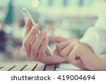 Small photo of close up woman's hand holding mobile phone device:focus work/play/read/call/text/type on smart phone concept:people and innovation technology conception.addiction of smartphone symptoms.vintage effect