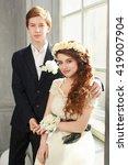 Small photo of Cute Teenage Prom Couple in beautiful interior