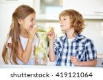 two children drinking fresh... | Shutterstock . vector #419121064
