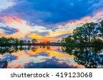 sunset on the lake | Shutterstock . vector #419123068