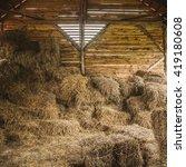 Dry Hay Stacks In Rural Wooden...