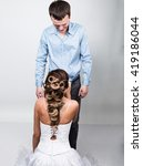 Small photo of beautiful young couple in love, bride knelt before the groom. provocation playful couple