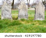 Three Old Graves Stones On A...