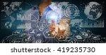 businesswoman using futuristic... | Shutterstock . vector #419235730