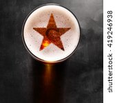 star symbol on foam in glass on ... | Shutterstock . vector #419246938