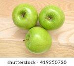 Three Fresh Green Apples On...