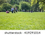 People Resting On Fresh Green...