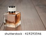 perfume bottle on the brown... | Shutterstock . vector #419293546