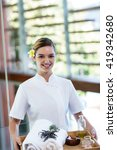 smiling masseuse holding a tray ... | Shutterstock . vector #419342680