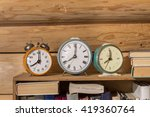 Old Alarm Clock On A Shelf Wit...