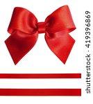 red satin bow and ribbon...