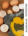 broken eggs on forged metal... | Shutterstock . vector #419492560