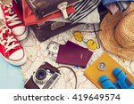 holiday suitcase on wooden table | Shutterstock . vector #419649574