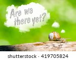 Small photo of Snail in the forest thinking are we there yet