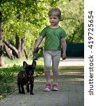 Proud Little Girl Walking With...
