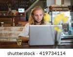 man working in a cafe on a... | Shutterstock . vector #419734114