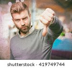 blond man angry expression | Shutterstock . vector #419749744