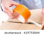 hands with roll of transparent... | Shutterstock . vector #419753044