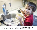 a little cute boy washing dishes | Shutterstock . vector #419759218