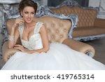 the girl in a wedding dress....   Shutterstock . vector #419765314