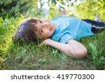 little boy in grass | Shutterstock . vector #419770300