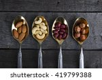 mixed nuts in metal spoon on... | Shutterstock . vector #419799388