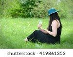 beautiful young woman sitting... | Shutterstock . vector #419861353