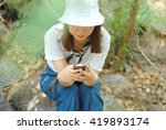 a girl looking at her telephone ... | Shutterstock . vector #419893174