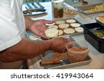 Professional chef preparing a gourmet meal - stock photo