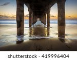 Sunset Under A Pier On The...