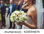 wedding bouquet at bride's hands | Shutterstock . vector #420054874