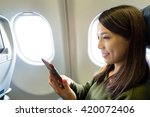 woman using cellphone inside... | Shutterstock . vector #420072406