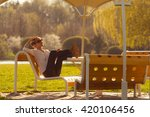 young woman relaxing  in the... | Shutterstock . vector #420106456