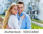 young couple smiling outdoors  | Shutterstock . vector #420116860
