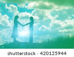 silhouette of two girls facing...
