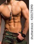 Army style shirtless man body with muscular torso