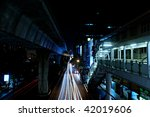 Busy Bangkok street at night with car motion blur. - stock photo