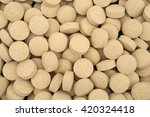Small photo of A very close view of brewer's yeast nutritional supplement tablets.