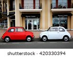 Small photo of Menton, France - May 14, 2016: Two small Italian cars Fiat 500 Parked in a Parking Lot in Menton. The red car is a Fiat 500 R and the white is a Fiat 500 F