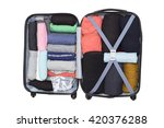 open suitcase with clothing on... | Shutterstock . vector #420376288
